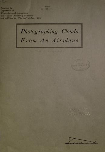 Photographing clouds from an airplane by Carpenter, Ford A.